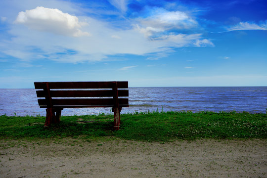 Beautiful Afternoon Scenic Solitary Bench View of the Lake and Sky