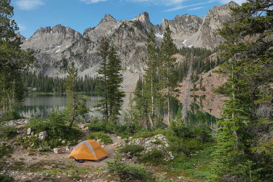 Alice Lake backcountry camp Sawtooth Mountains;Orange backpacking tent at Alice Lake Sawtooth Mountains Idaho, Idaho, United States
