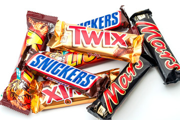 Croydon,UK - January 25, 2020: Illustrative editorial of mixed chocolate candy bars still in wrapper (Snickers, Mars, Lion and Twix) isolated on white background