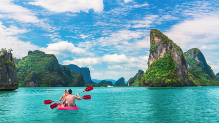 Beautiful nature scenic landscape island with activity couple traveler kayaking Phang-Nga bay, Tourist adventure travel Phuket Thailand, Tourism destination place Asia, Summer holiday vacation trip Fotomurales