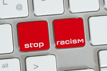 Ein Computer und Tasten für Stop Rassismus