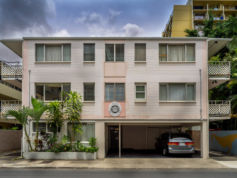 Older apartment building on April 26, 2014 in Waikiki, Hawaii. Waikiki has many apartments buildings that have seen better days, but support the surf culture.