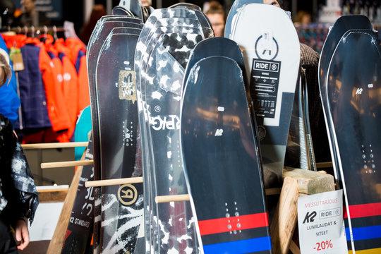 HELSINKI, FINLAND - NOVEMBER 15, 2019: Ski shop sale. Rows of different snowboards in sport equipment store