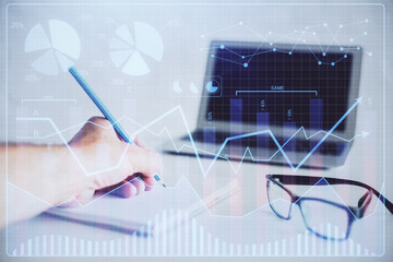 Multi exposure of man hands with stock market forex graph.