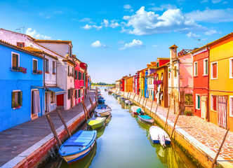 Venice landmark, Burano island canal, colorful houses and boats, Italy Fotomurales