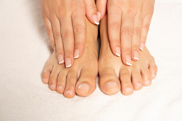 a young woman with a beautifully done manicure and pedicure