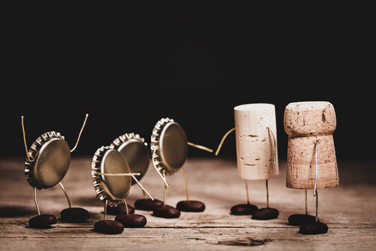 Crown cork, wine and champagne cork miniature figures with a handshake, concept friendship and altruism