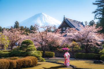 Woman walking in Temple near Mt.Fuji in Japan
