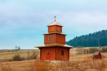 Wall Mural - Wooden church on the field, Ukraine, Europe