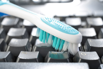 Cleaning Keyboard from Dust Using Toothbrush
