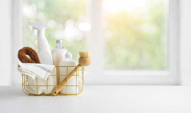 Eco-friendly natural cleaning products on table and window background