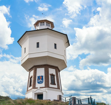 A lighthouse and water tower at the island of Langeoog, East Frisian islands, Lower Saxony, Germany