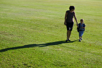 Mother and daughter walking together to school