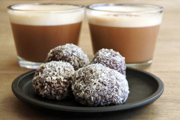 Sweet Chocolate balls served with two cups of cappuccino