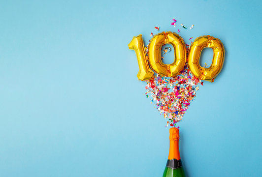 100th anniversary champagne bottle balloon pop