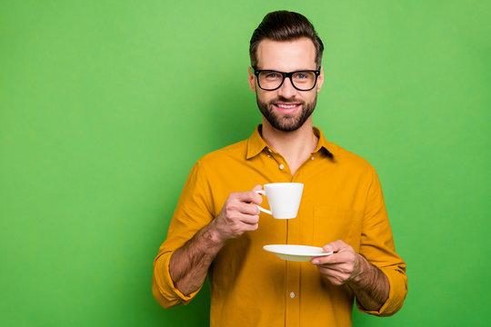 Close-up portrait of his he nice attractive handsome cheerful cheery bearded guy in casual formal shirt drinking latte isolated on bright vivid shine vibrant green color background