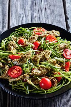 close-up of chicken zucchini pasta tomato salad