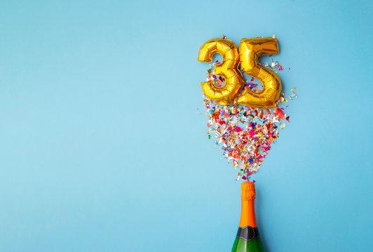 35th anniversary champagne bottle balloon pop