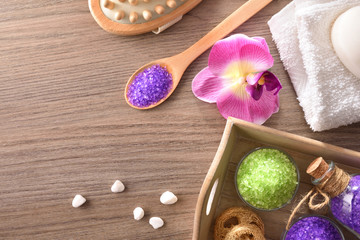 body care products on tray on wooden table top