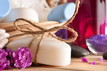 Massage and bath products on wooden table front detail