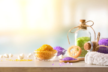 Products for body wellness on wooden table spa background