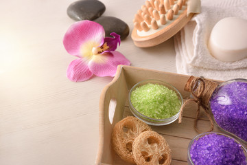 Products for body wellness on wooden tray elevated view