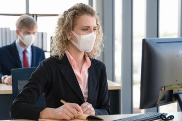 caucasian businesspeople with medical mask for coronavirus covid-19 protection working in office Wall mural