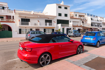 Menorca, Spain - October 12, 2019: Red Audi A3 cabriolet is parked on the street on a sunny day