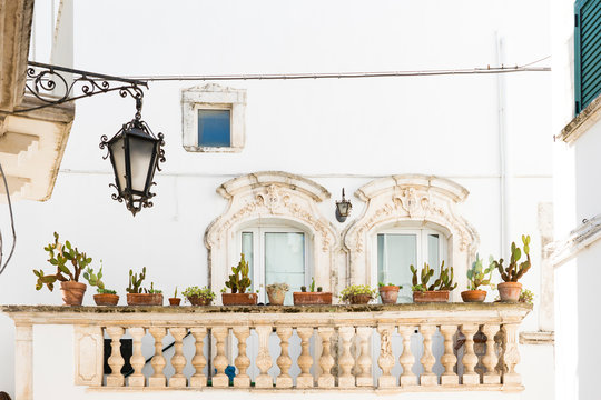 white house with balcony and cactus plants in Martina Franca, Italy