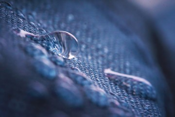 Acrylic Prints Macro photography Water drops on impregnated waterproof fabric.