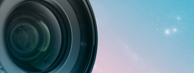 Beautiful camera lens with green light of glass on a abstract contemporary colors and mood social background.  ..