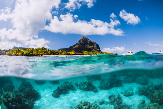 Blue ocean underwater and Le Morne mountain in Mauritius.