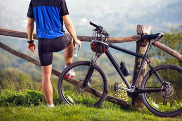 Zelfklevend Fotobehang Ontspanning Biker on break enjoy in nature .Spring, nature ,sport concept