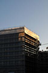 tarpaulin at construction site reflecting morning sunlight