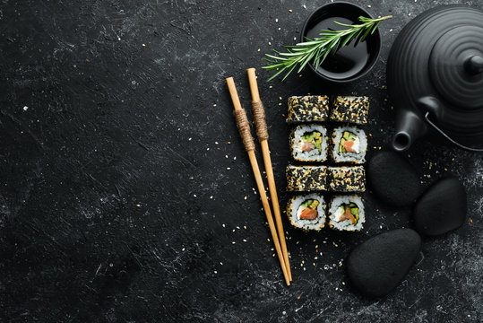Sushi Rolls - California with sesame, salmon and avocado. Set of sushi rolls of seafood
