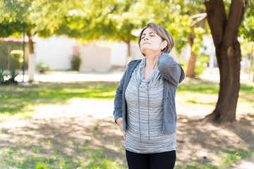 Active Woman Suffering From Neck Pain