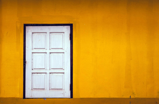 Yellow old wall With 1 door with copy space