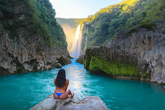 TAMUL, SAN LUIS POTOSI MEXICO - January 6, 2020:young women posing in River amazing crystalline blue water of Tamul waterfall