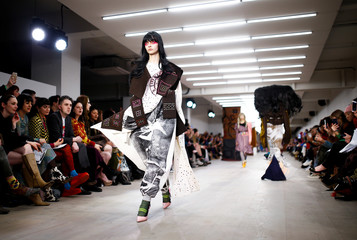 Models present creations during the Matty Bovan catwalk show at London Fashion Week in London