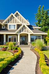 Obraz A nice entrance of a luxury house over blue sky and outdoor landscape - fototapety do salonu