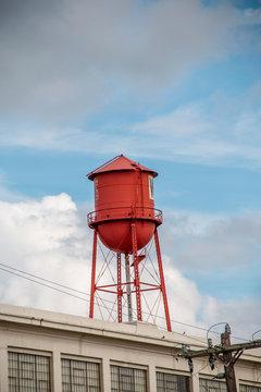 Red water tower in Winston Salem North Carolina