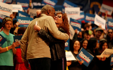 Actor Susan Sarandon shares a hug actor Danny Glover at a campaign rally for Democratic U.S. presidential candidate Senator Bernie Sanders in Charlotte