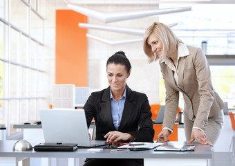 Female business team working on laptop computer