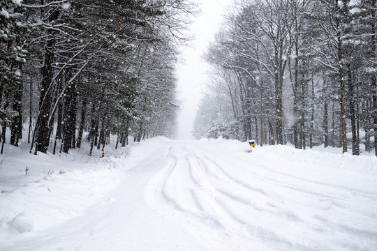 Snow covered road  in a February snowstorm in Wausau, Wisconsin, horizontal