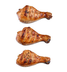 Fototapete - Grill roast bbq chicken leg isolated on white background