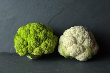 white and green cauliflower on gray background