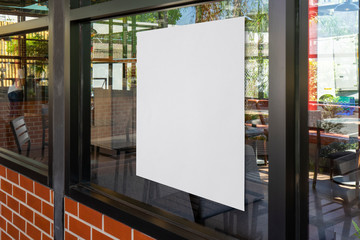 Mock-up billboard or white paper poster promotion  display on the front restaurant or coffee shop. Blank paper for Promotion information for marketing announcements and details. Wall mural
