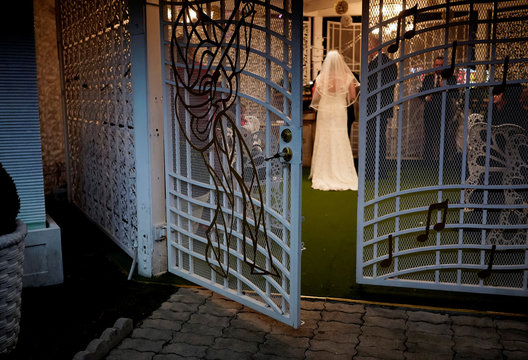 People are seen at a wedding chapel on Valentine's Day in Las Vegas