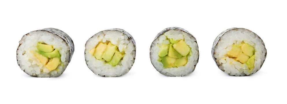 Delicious sushi rolls with avocado on white background