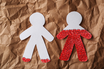 Human paper figures on brown background, flat lay. Relationship problems concept